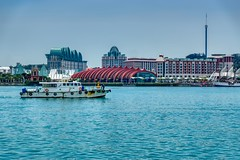 Singapore harbour with boat and view of the resorts and casinos on Sentosa island (UweBKK (α 77 on )) Tags: singapore southeast asia sony alpha 77 slt dslr city urban harbour harbourfront ship boat water sentosa island resort casino