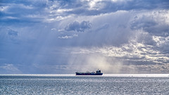A late sun shower (John Hewitt 7) Tags: luminosity7 nikond850 melbourne victoria australia spiritoftasmaniaii sunshower weather ships boats fishingboats clouds sky moodysky reflectionsofsunlightonthewater