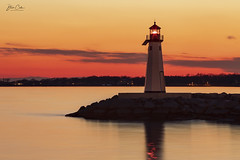Sunset in Patchogue Bay (NYRBlue94) Tags: lighthouse longisland patchogue newyork light sunset dusk orange yellow jetty rock bay