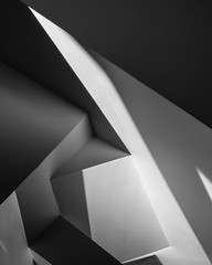 collision of opposing desires (Reflectory (Chris Brown)) Tags: abstract abstraction minimal minimalism minimalistic nopeople nonobjective vertical portrait white grey gray black bw blackandwhite diagonal lines planes triangle geometry shadow shadows dry wall corner reflectory