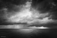 Out at sea (He Ro.) Tags: fischlanddarsszingst blackwhite schwarzweis bw dramatic clouds dark darkmood moody sea ostsee balticsea seascape germany deutschland nature outdoors rain showers fischlanddarszingst
