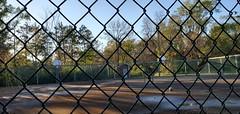 chained off (Mamluke) Tags: fence chained chainlink basketball court basketballcourt ball autumn fall wet rain sunlight baskets empty mamluke wisconsin