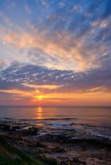 February morning, Spain (Vest der ute) Tags: xt2 spain sea seaside rocks clouds cloudscape sunrise waves grass sand flower fav25 fav200