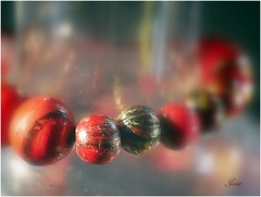 Painted Beads (jesse1dog) Tags: enlargerlens panasoniclumixgm1 extensiontube tabletop beads paintedbeads soligarf3550mm glasscarafe red black chipped macromondays painted
