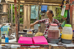 Something is cooking. (Beegee49) Tags: street people food cooking cart woman filipina happy planet sony nex silay city philippines asia