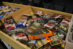 A Table Full of Models for Sale, Train Show at the State Fairgrounds, Tampa, Florida (gg1electrice60) Tags: cars buses table vehicles trucks modelcars muted modelrailroads woodentable mutedbackground darkenedbackground modeltractors railfanmagazines railroadmagazines collections sets singles potpourri selections diecast scalemodels matchboxcars trainshow dodads hotrodmagazines tampa tampabay amusements layouts statefairgrounds floridastatefairgrounds hillsboroughcounty modelrailroadshow tampametropolitanarea tampametroarea usa slr america us unitedstates florida fl dslr singlelensreflexcamera canoneos40d canon40d digitalsinglelensreflexcamera magazines canondigitalcamera colorful exhibitionhall