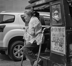Coming down (Beegee49) Tags: street people elderly woman public transport blackandwhite monochrome sony nex bacolod bw city philippines asia