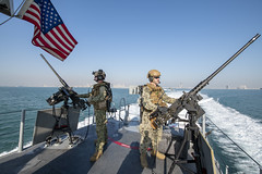Sailors man M2A1 .50-caliber machine guns aboard a Mark VI patrol boat.
