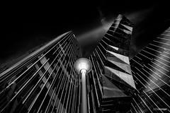 BCN XXXVII (dark version) (Holger Glaab) Tags: modernarchitecture architecture skyscraper building streetlamp bnw blackandwhite blackwhite monochrome fineart barcelona
