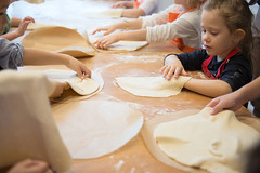 Hands of children rolling pizza dough on the kitchen table. Making pizza. (NY Kitchen) Tags: pizza kitchen pastry rolling rollingpin bake baker bakery bread cake child childhood cook cooking copyspace cuisine development dough education family flour food fun girl handmade hands home homemade housework ingredient knead kneading lifestyle little making meal pastel preparation prepare raw table traditional russianfederation