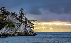 Stone cold  -   Whytecliff Park (Christie : Colour & Light Collection) Tags: light clouds evening park bc britishcolumbia whytecliffpark westvancouver cliff person skylight hiker islet ruggedcoast whyteislet trees silhouette outside outdoors nikon albert nikkor colonel districtofwestvancouver whytel whitecliffcity weather northamerica oceanview metrovancouver ocean landscape pacificocean stormy howesound layers rock island boulder waterline goldenhour edge cliffside horizon rocky zoom longzoom lighting coldtemperature cold