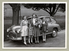 """Standard Vanguard (Vintage Cars & People) Tags: white black classic cars car vintage photography photo automobile foto sw """"blackwhite"""" fashion shirt suit motor standard vanguard phase1 standardvanguard trachtenanzug alpinesuit woman lady femalesuit ladyssuit fifties 1950s 50s family boy girl childhood kids children flowers bunch bouquet shorts bobbysocks blouse countryside countryroad"""