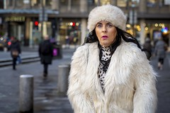 Abominable (Leanne Boulton) Tags: urban street candid portrait portraiture streetphotography candidstreetphotography candidportrait streetportrait eyecontact candideyecontact streetlife woman female lady face eyes expression mood emotion feeling shock shocked surprise surprised fur furry fluffy coat hat style fashion tone texture detail depthoffield bokeh naturallight outdoor light shade city scene human life living humanity society culture lifestyle people canon canon5dmkiii 70mm ef2470mmf28liiusm colour glasgow scotland uk