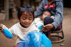 Laotian little girl sewing 2 (Alex_Saurel) Tags: satisfaction son asia females horizontal colorimage laotianethnicity cheerful contentedemotion happiness candid laos women enjoyment positiveemotion people youngfamily laotianculture two southeasternasia joy child portrait lifestyles family toddler girls chaleunsouk 23years vitality luangnamtha realpeople preschoolage southeastasia onlygirls smiling laughing sony50mmf14sal50f14