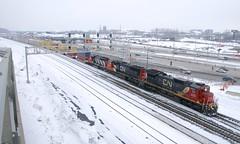 Crossing over (Michael Berry Railfan) Tags: cn canadiannational montreal quebec cn401 train freighttrain ge generalelectric c408 dash8 dash840c sd70i gp402lw cn2019 cn5608 cn9410