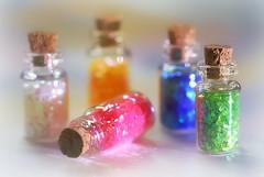 Fairy Dust (Through Serena's Lens) Tags: dof bokeh sparkle bottle colorful macro stilllife tabletop canoneos6dmark