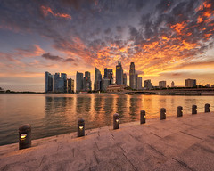 Dramatic Bayfront Sunset (Scintt) Tags: singapore wideangle traditional city cityscape hall marinabay rafflesplace tanjongpagar financial cbd central business district offices towers skyscrapers skyline sky clouds sun light contrast tones travel tourism architecture buildings urban modern exploration steps waterfront scintt scintillation jonchiangphotography fullerton bridge hotel expensive processed neutraldensity sony a7rii 1635 golden reflection clear sunset dusk evening iconic hny water lake pond reservoir cloud dramatic orange red glow panorama stitched pano lights skyscraper dreamy tourist esplanade