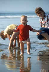 Baby Beach Bliss (moonjazz) Tags: baby beach cute red ocean family photo candid joy discovery california barefoot play children kids sand mom vacation diapers growingup childhood age one happiness delight jubilant funny nature walking memories enjoy toes toddler wife sons excited