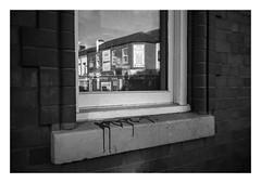 FILM - Stained window ledge (fishyfish_arcade) Tags: 35mm analogphotography bw blackwhite blackandwhite canonsureshotmax delta400 filmphotography filmisnotdead istillshootfilm monochrome analogcamera compactcamera film ilford mono streetphotography reflection