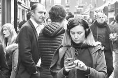 London Street Scene...... (markwilkins64) Tags: struttonground westminster london uk streetphotography street candid streetscene blackandwhite bw monochrome mono mobilephone headphones lunchtime markwilkins market conversation grainy juxtaposition contrast
