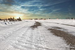 Chemin Maurice (Shawn Harquail) Tags: canada newbrunswick shawnharquail sunset clouds houses ice landscape outdoor outdoors outside road shawnharquailcom sky snow street winter