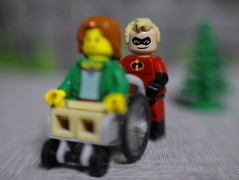 Mr Incredible is always happy to help. (DayBreak.Images) Tags: tabletop toys lego minifigures mrincredible wheelchair girl canondslr lensbabysol45 extensiontube ringlight