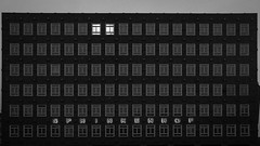 Working late (Özgür Gürgey) Tags: 2020 20mm bw d750 hamburg kontorhausviertel nikon sprinkenhof voigtländer architecture evening grainy repetition windows 169