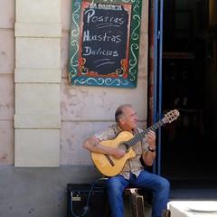 Making music (halifaxlight) Tags: argentina buenosaires laboca street cafe musician guitar door menuboard sitting playing square