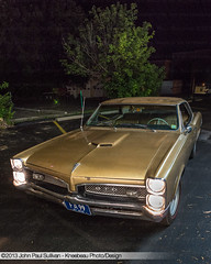 1967 Pontiac GTO named Goldie in the evening with headlamps on front 3/4 View (John P Sullivan) Tags: redline athens gm 67 dslr grille generalmotors gold headlamps musclecar frontview auto goldie classic signetgold dark front automobile nikond800 pontiac portrait nightime nikon d800 gto ohio hardtop johnpaulsullivan goat 1967 night car 34view headlights frontend johnpsullivan kneebeau hotrod evening