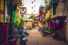 An ordinary day - on the streets - Hanoi (Sonia gsgs) Tags: hanoi vietnam streetphotography streets urbanphotography urban sonya6000 sonyalpha mirrorless 1650mm colorful motorbike houses flags