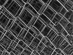 grid over grid (Rosmarie Voegtli) Tags: grids fence rolledup blackandwhite abstract dornach storm sabine work repair arbeit iphone againandagainandagain