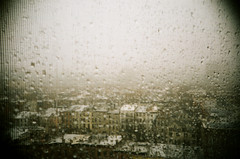 Grey Days Ahead (Gabriella Ollandini) Tags: rain raindrops city grain texture cityscape view urban weather 35mm filmisnotdead filmphotography filmcamera istillshootfilm lomography 800 grey buildings analog analogue analogica vintagecamera vignette landscape winter lca brooklyn nyc