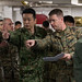 U.S., Japanese senior leaders discuss an upcoming simulated mission aboard the amphibious assault ship USS America