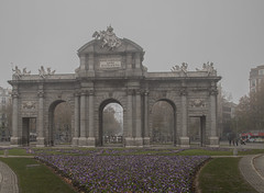 Puerta de Alcalá (Alcala Gate) (fnks) Tags: spain madrid parc buenretiro palace cottage pond trees misty foggy colonnade statue ruins facade guard monument vacation holidays sky clouds blue water forest