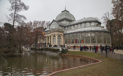 Palacio de Cristal 1(Crystal Palace) (fnks) Tags: spain madrid parc buenretiro palace cottage pond trees misty foggy colonnade statue ruins facade guard monument vacation holidays sky clouds blue water forest