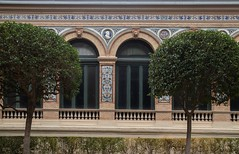 Part of the facade of Palacio de Velázquez(Velázquez Palace) (fnks) Tags: spain madrid parc buenretiro palace cottage pond trees misty foggy colonnade statue ruins facade guard monument vacation holidays sky clouds blue water forest
