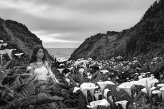 Surrounded by lilies (PeterThoeny) Tags: callalilyvalley carmelbythesea carmel california usa lily flower bloom blossom woman portrait dress white whitedress sky valley outdoor cloudy day monochrome backandwhite sony sonya7 a7 a7ii a7mii alpha7mii ilce7m2 fullframe vintagelens dreamlens canon50mmf095 canon 2xp raw photomatix hdr qualityhdr qualityhdrphotography fav100