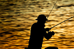 The Fisherman (TS Lichtreise) Tags: outside sunset beach yellow orange outdoors fishing fishingrod nature water silhouette sport lake standing man relaxation angel fischer bart hut schwarz black hat