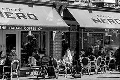 Out and about in Tunbridge Wells (aquanout) Tags: blackandwhite bw monochrome street people town shops chairs outside