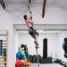 Strong young girl in sport hall on the rope
