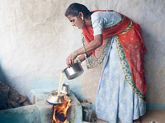 Cooking milk (Dick Verton ( more than 15.000.000 visitors )) Tags: travel india colorfulwomen blue kitchen cooking fire rajasthan