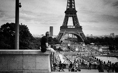 The man next to the tower (Missing Pictures) Tags: street blackandwhite paris france tower film monochrome explore streetphoto filmcamera peopleonthestreet explored