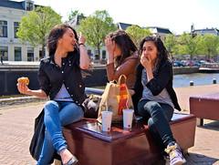 Caught you! (Hindrik S) Tags: food eat eating girls joy meal surprised sofa couch bench bank leeuwarden liwwadden ljouwert famkes vrouw female femme frau lady jeans bag hand laugh laughing streetphoto streetphotography strjitfotografy strase strjitte straat straatfotografie dutch netherlands nederland sonyphotographing sony sonyalpha a300 α300 alpha300 sonya300 tamronspaf1750mmf28xrdiiildasphericalif tamron tamron1750 on1photoraw on1pics