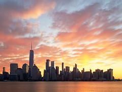 Sunrise February 9, 2020 (Ralph Cherubin) Tags: olympus panasonic ep5 12mm32mm february 2020 newyorkcity ny oneworldtradecenter manhattan hudsonriver sunrise clouds longexposure skyline skyscraper water