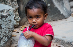 2019 - Cambodia - Siem Reap - Ta Prohm - 28 (Ted's photos - For Me & You) Tags: 2019 avalonwaterways cambodia cropped nikon nikond750 nikonfx siemreap taprohm tedmcgrath tedsphotos vignetting boy youngboy lad tyke cuteboy straw drinking sucking suckingonastraw taprohmsiemreap cute cutekid shallowdof 1people candid candideyecontact