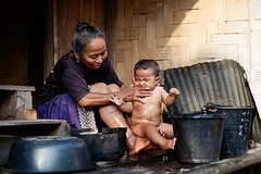 Laotian senior woman washing baby (Alex_Saurel) Tags: men horizontal asia son females bathing colorimage people boys women adult mother males laos domesticlife offspring residentialbuilding laotianethnicity family girls portrait baby child group parent luangnamtha midadult realpeople southeasternasia laotianculture chaleunsouk 3039years southeastasia father sony50mmf14sal50f14