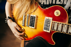 Attractive rock girl with beautiful hair playing Gibson Les Paul closeup (shixart1985) Tags: backstage beautiful cherrysunburst chords closeup compose distortion education fingers gibson hair hipster learn lespaul live mahagony metal music orange paf59 pickup play playing pot red rock school stage