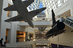 Flyover Country (MPnormaleye) Tags: jet airplane fighter airborne flying atrium windows lobby museum historic science la utata wideangle escalator
