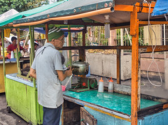 Something is cooking-Not sure What. (Beegee49) Tags: street people man cooking saucepan cart snacks happyplanet sony a99 silay city philippines asia