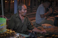 In the night market, Ranong (villy7335022) Tags: old elder merchant trader food street streetfood ranong thailand thai southern hair age eatable people local rural mustache tourism man asian asia asean siam simaese meatball